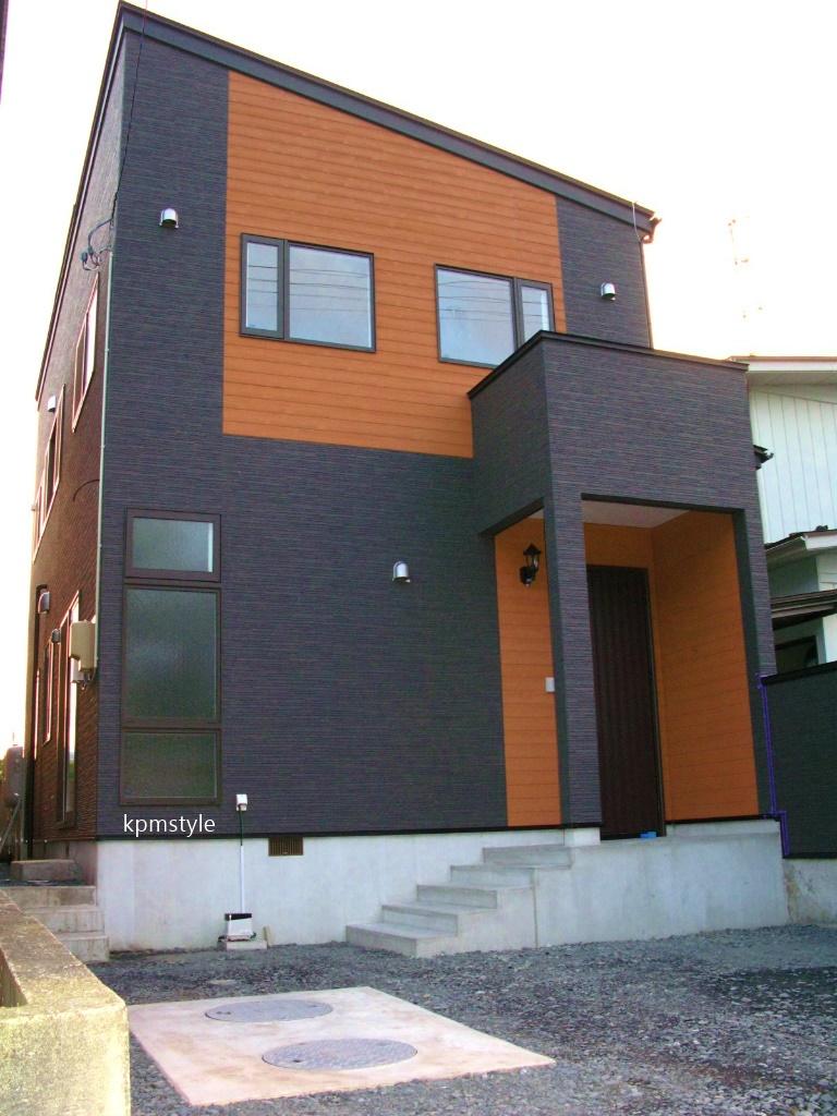 コンクリートテイストのエントリークローゼットがある家 (八戸市鮫町)